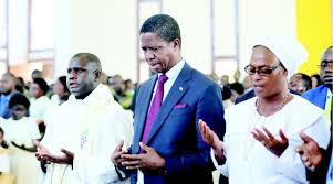 President Lungu praying in church